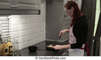 Woman fry the shrimp in a skillet