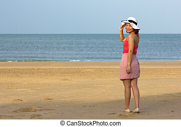 Woman full length with beach front