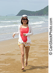 Woman full length with running on the beach