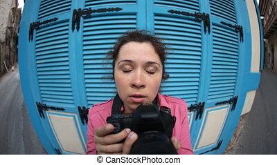 Woman Funny fisheye photographer - Young Woman Funny fisheye...