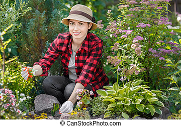 woman gardener pulling out the weeds