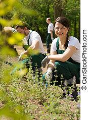 Woman gardener smiling
