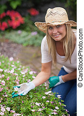 Woman gardening and touching flower