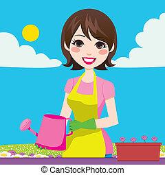 Woman Gardening - Beautiful woman doing gardening outdoors ...
