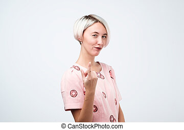 Woman gesturing come here calling you isolated on a white background