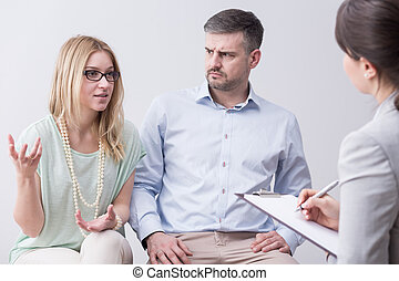 Woman gesturing during marriage psychotherapy session