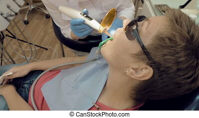 Woman gets dental help to fill a cavity in a tooth - Woman...