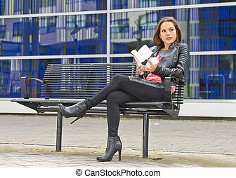 Woman gets distrated reading a book - Pretty woman on her...