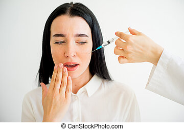 Woman gets facial injection