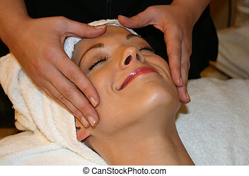 Woman Gets Facial - Woman smiles as she gets a facial...