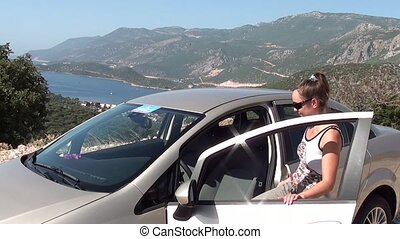 Woman gets into the carWoman gets in the car and closes the...