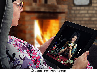 Woman gets online tarot reading - Mature woman sits in a ...