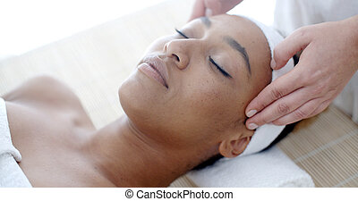 Woman Getting A Face Treatment At Spa