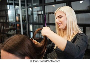 Woman getting a hair cut at the beauty salon
