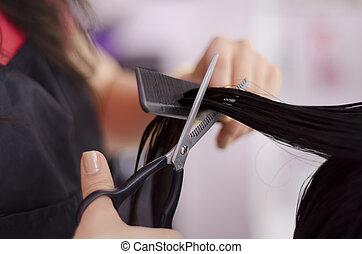 Woman getting a haircut at a salon