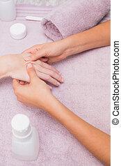 Woman getting a hand massage
