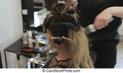 Woman getting a new hairstyle in the salon