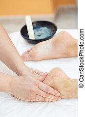 Woman Getting a Salt Scrub Beauty Treatment in the Health Spa