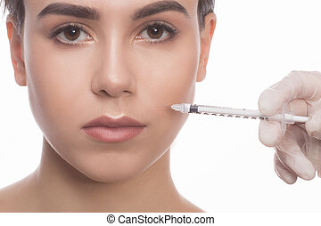 Woman getting beauty facial injections