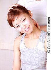 chiropractic - woman getting chiropractic