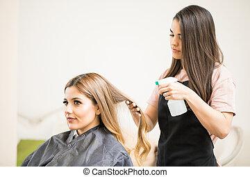 Woman getting haircut in a salon