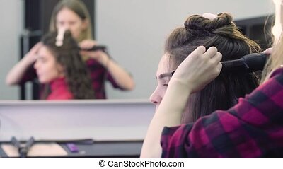 Woman getting hairdressing in hair salon - Young attractive...