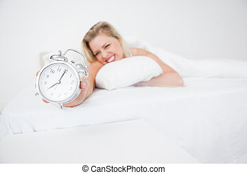Woman getting her alarm clock