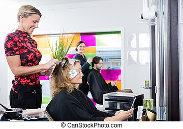 Woman Getting Her Hair Colored In Salon