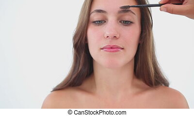 Woman getting her make up applied