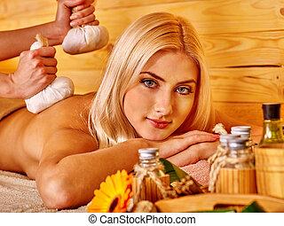 Woman getting herbal ball massage . - Blond woman getting...