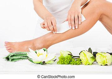 Woman Getting Legs Waxed - Beautician Waxing A Woman's Leg...