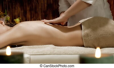 Woman getting massage in spa relaxing dolly shot