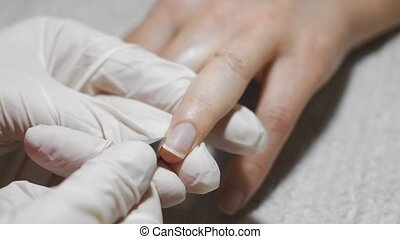 Woman getting nail manicure. Prepare for varnish coating. -...