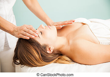 Woman getting positive energy at a spa