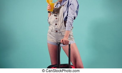 Woman getting ready to go on a trip on a blue background. -...