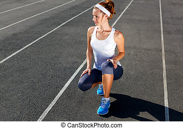 Woman getting ready to start on Stadium.