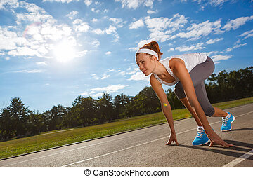 Woman getting ready to start on Stadium. - Woman getting ...