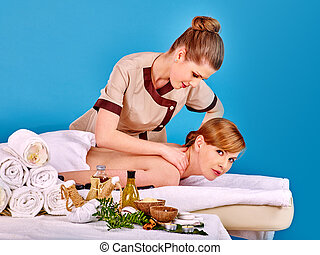 Woman getting spa lastone therapy outdoor.