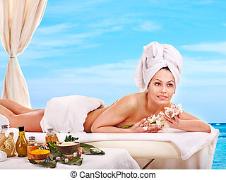 Woman getting spa outdoor.