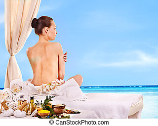 Woman getting spa therapy outdoor.