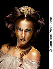 Woman gilded golden face - theater luxury make up - Dramatic...
