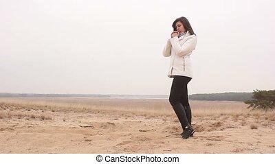 woman girl autumn cold hands warm nature sand landscape...