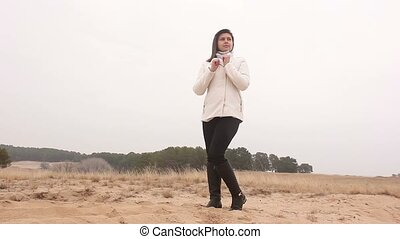 woman girl autumn cold hands warm nature landscape sand  steppe
