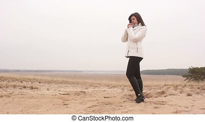 woman girl autumn cold hands warm nature sand landscape steppe