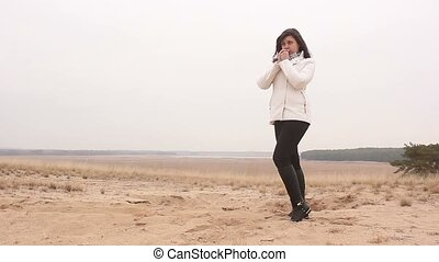 woman girl autumn cold hands warm nature sand steppe landscape