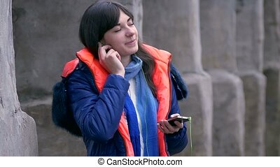 woman girl closed eyes listening to music on smartphone...