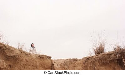 woman girl jumping nature in autumn nature sand - woman girl...