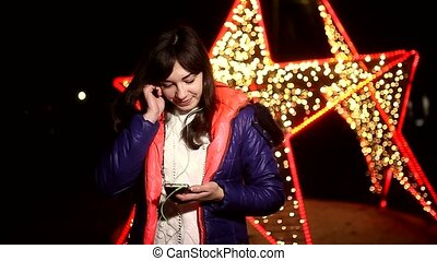 woman girl listening to music on your phone with headphones...