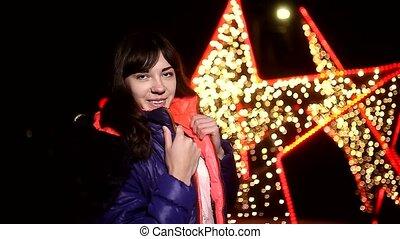 woman girl night jacket scarf and dark winter light bokeh star