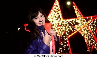 woman girl night jacket scarf and dark winter light star bokeh